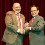 Ken Casavant, left, receives the award March 27 from Provost Dan Bernardo. (Photo by Shelly Hanks, WSU Photo Services)
