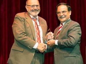 Ken Casavant, left, receives the award March 27 from Provost Dan Bernardo. (Photo by Shelly Hanks, WSU Photo Services)