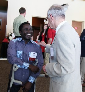 CAHNRS student and scholarship recipient Charles Diako visits with Jim Ruck, his scholarship donor. Ruck won Volunteer of the Year honors jointly with his wife, Lee Ella.