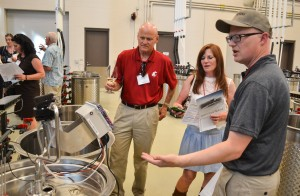 Associate Professor of Enology Jim Harbertson shows new equipment to visitors at the new Ste. Michelle Wine Estates WSU Wine Science Center.