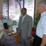 In 2008, WSU President Elson Floyd meets with members of the Washington Wheat Commission (now known as the Washington Grain Commission) at their Spokane office. Pictured are CEO Tom Mick, Randy Suess, Floyd, and Hal Johnson.