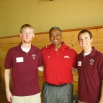 WSU President Elson Floyd visits with members of the Student Swine Cooperative.