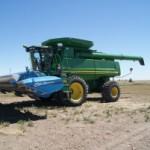 stripper header for harvesting wheat