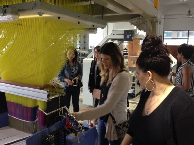 Alison Dephillips and Nikki Norman inspect a 3-D weaving machine at Donghua University, Shanghai.