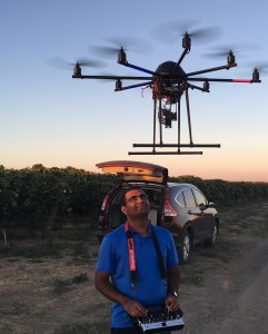 WSU professor Lav Khot prepares to fly the 8-bladed octo-copter over a vineyard to measure how effectively a new irrigation method gets water to the vines.