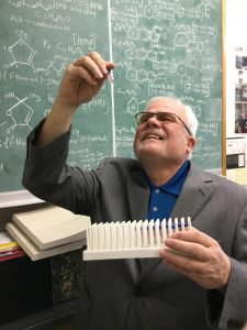 Senior scientist Robert Bonsall views a soil sample to be studied in the new mass spectrometer.