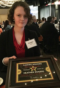Heather Rogers shows off her Outstanding Junior in Agriculture Award at CAHNRS Honors.