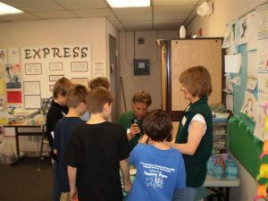 Spokane County Master Gardener volunteers work with students on a Garden in a Box program this spring.