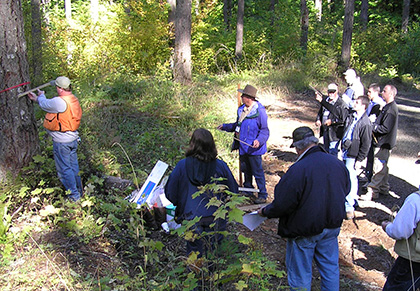 """WSU Extension Forester Andy Perleberg leads the """"Measuring Your Trees"""" class, one of a two-part session on forest inventory."""