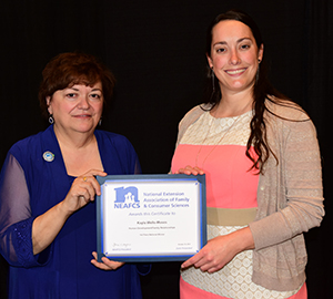 Kayla Wells-Moses accepts a national award at the 2017 NEAFCS conference.