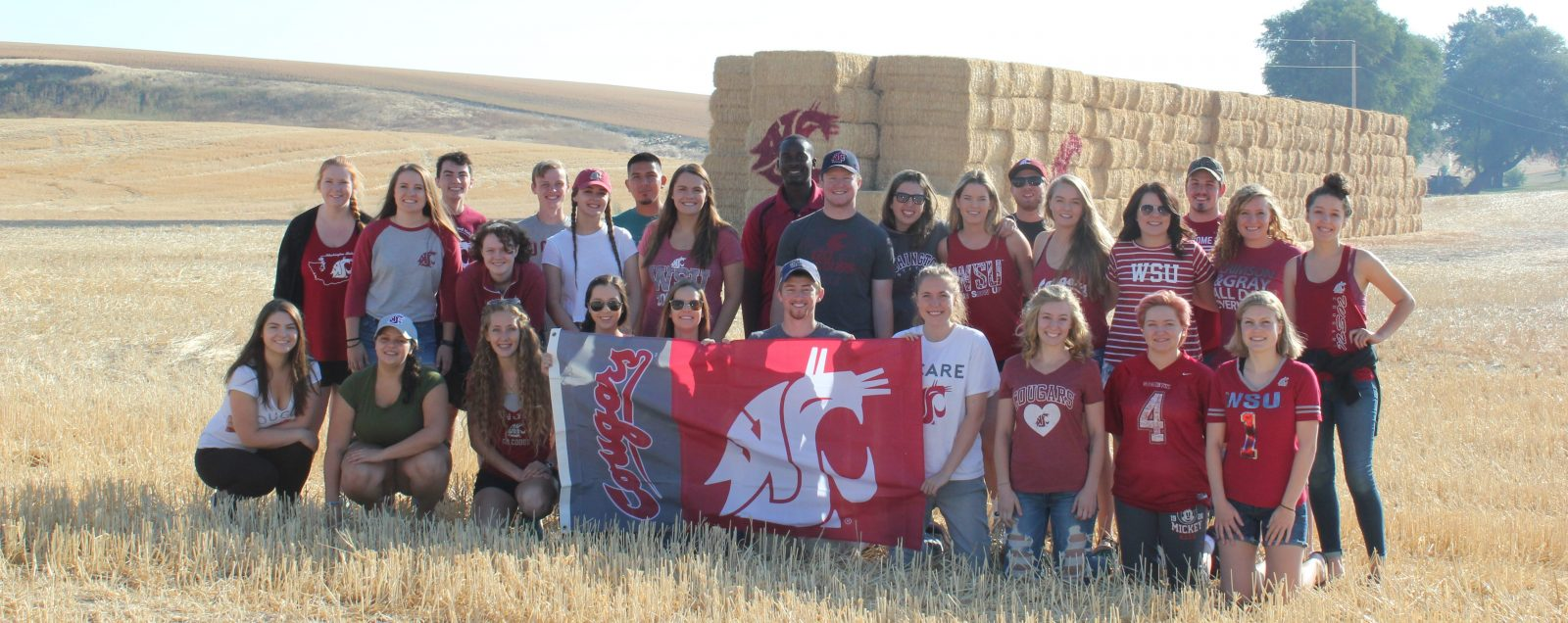 CAHNRS Ambassadors with WSU Flag