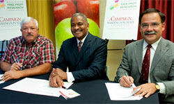 Jim Doornink, Elson Floyd, Dan Bernardo signing the donation and research agreement.