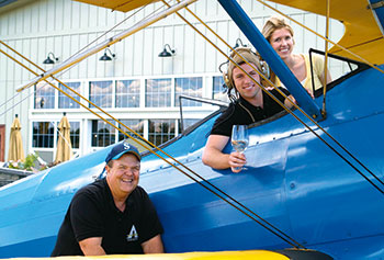 Mike Miller, Marc Miller, and Lori Stevens take flight at Airfield Estates.