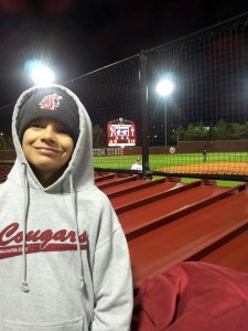 Robbie Mensonides, son of Rob ('97, Ag. Econ.) and Kami Turner Mensonides ('97, Ag. Econ.), all decked out in Cougar gear for a baseball game after Alumni Association meetings.
