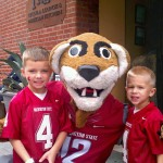 Future Cougs Reagan and Raleigh Morgan pose with Butch for Dad, Tyler ('01, Ag. Econ), at the November 2012 WSU vs. Cal game.