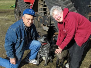 Dick and Helen Appel with a dog and lamb.