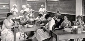 A group of women around tables making baskets.