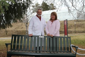 Russ Salvadalena, manager of the WSU Creamery, and Carol Hanson, daughter of the late Dr. Lloyd Luedecke, visit the memorial bench dedicated to the professor. Last fall, Luedecke's family donated funds for the bench to create a space where his students, friends and colleagues could remember him. Photo by Seth Truscott.