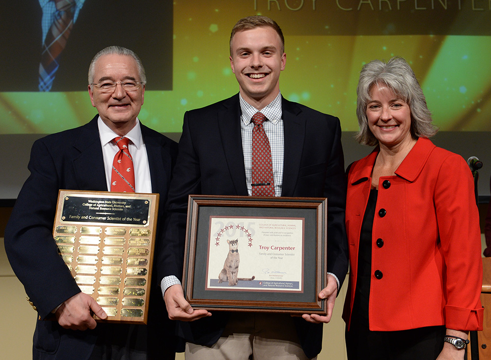 Troy Carpenter, center, with Ron Mittelhammer and Kim Kidwell