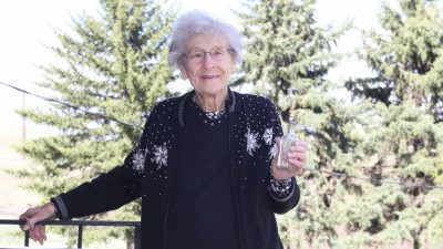 Myrtle Fulfs of Pullman, an endowment supporter of the WSU Department of Animal Sciences, holds the bottle that held her message along the bank of the Snake River for five decades.