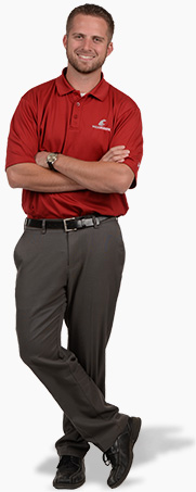 Man in red shirt and gray slacks standing.