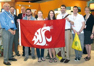 Students holding the WSU flag