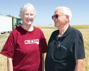 Carol Quigg and Jerry Sheffels standing in a field on the Wilke Farm