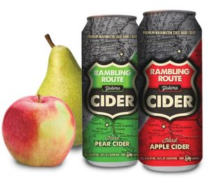 An apple and pear next to a hard apple and a hard pear cider Rambling Route Cider cans.