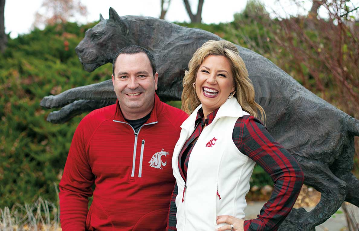 The Silers stadning in front of the cougar statue at the Lewis Alumni Center.