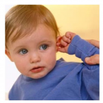 The image shows a toddler pulling on his ear, a common behavior when children have ear aches.