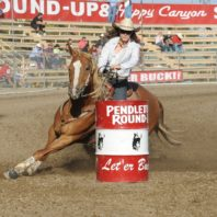 Jillian Connolly riding Sugar in a barrel race