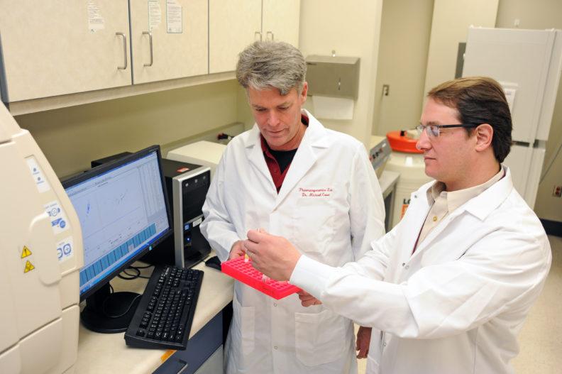 Michael Court and Nicolas Villarino in the lab