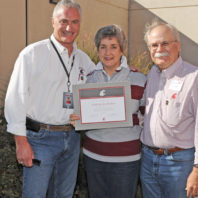 Kathy Slinker receiving certificate