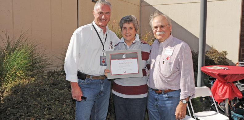 Kathy Slinker receiving certificate