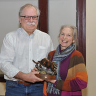 Kathleen Potter holding a cougar statue with Bryan Slinker