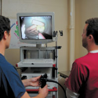 Nick Larson and Drew Fleischman using an endoscope
