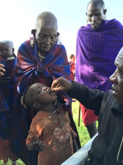 East African child receiving deworming medication