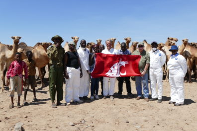 MERS study group in Marsabit, Kenya holding the Cougar flag