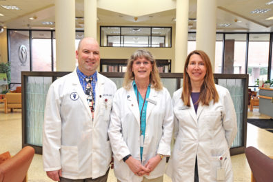 Veterinarians standing in the WSU Veterinary Teaching Hospital Library