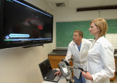 Drs. Ragel and Watkins looking at the screen.