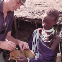 Dr. Lankester with a Maasai giving a puppy a rabies vaccination.