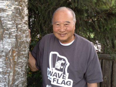 Dr. Nakata standing next to tree