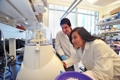 Dr. Goodman and Marena Guzman in Dr. Goodman's laboratory