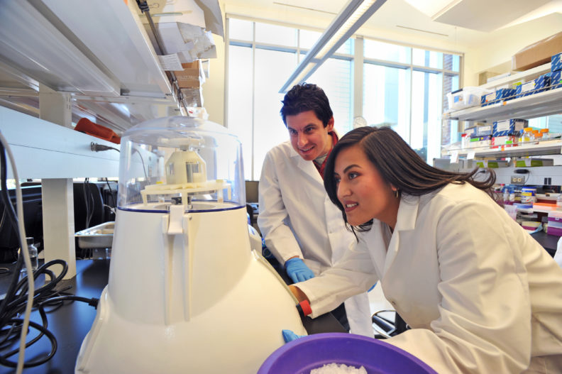 Dr. Goodman and Marena Guzman in Dr. Goodman's laboratory