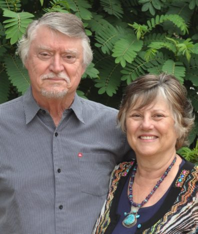 Portrait of Norm and Marlene in front of some greenery