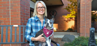 Portrait of Tami and Lucy. Lucy is wearing a Cancer Survivor scarf.
