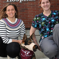 Emilia Terradas, a resident in veterinary Emergency and Critical Care, and tech assistant McKenzie Dress pose with Chief