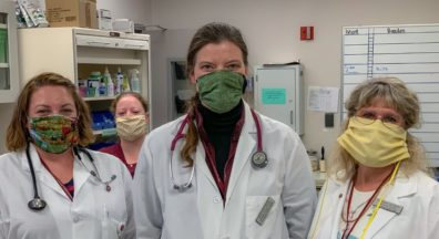 Wearing donated cloth masks