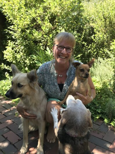 Dori with three dogs.