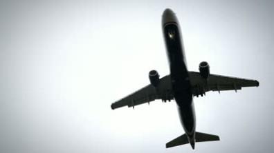 stock-footage-plane-landing-flying-overhead-in-silhouette-fps-slow-motion